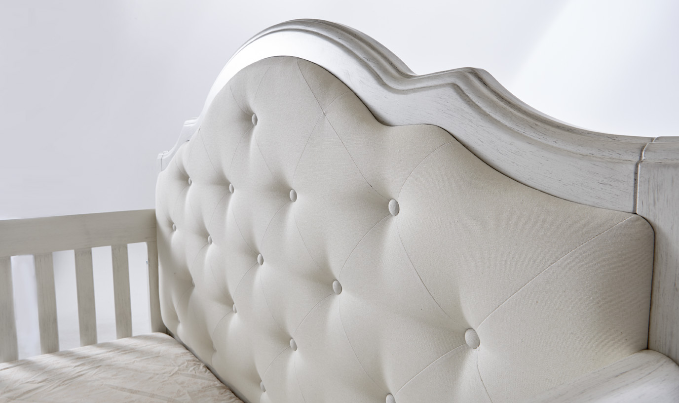 The <b>Cristallo Forever Crib</b> in Vintage White and with the Fabric Panel.