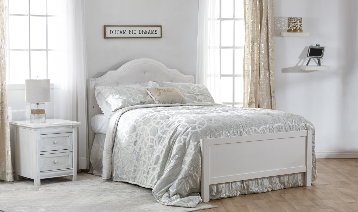 The <b>Cristallo Forever Crib</b>, converted into a <b>full-size bed</b>, with the Low Profile Footboard (sold separately) –