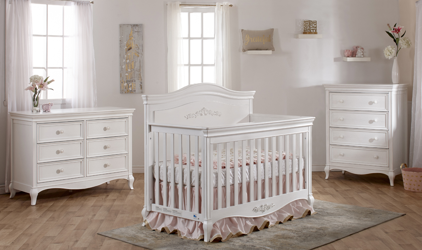 The <b>2403 Diamante Forever Crib</b> features a full panel headboard with a gorgeus <b>floral decor</b>.