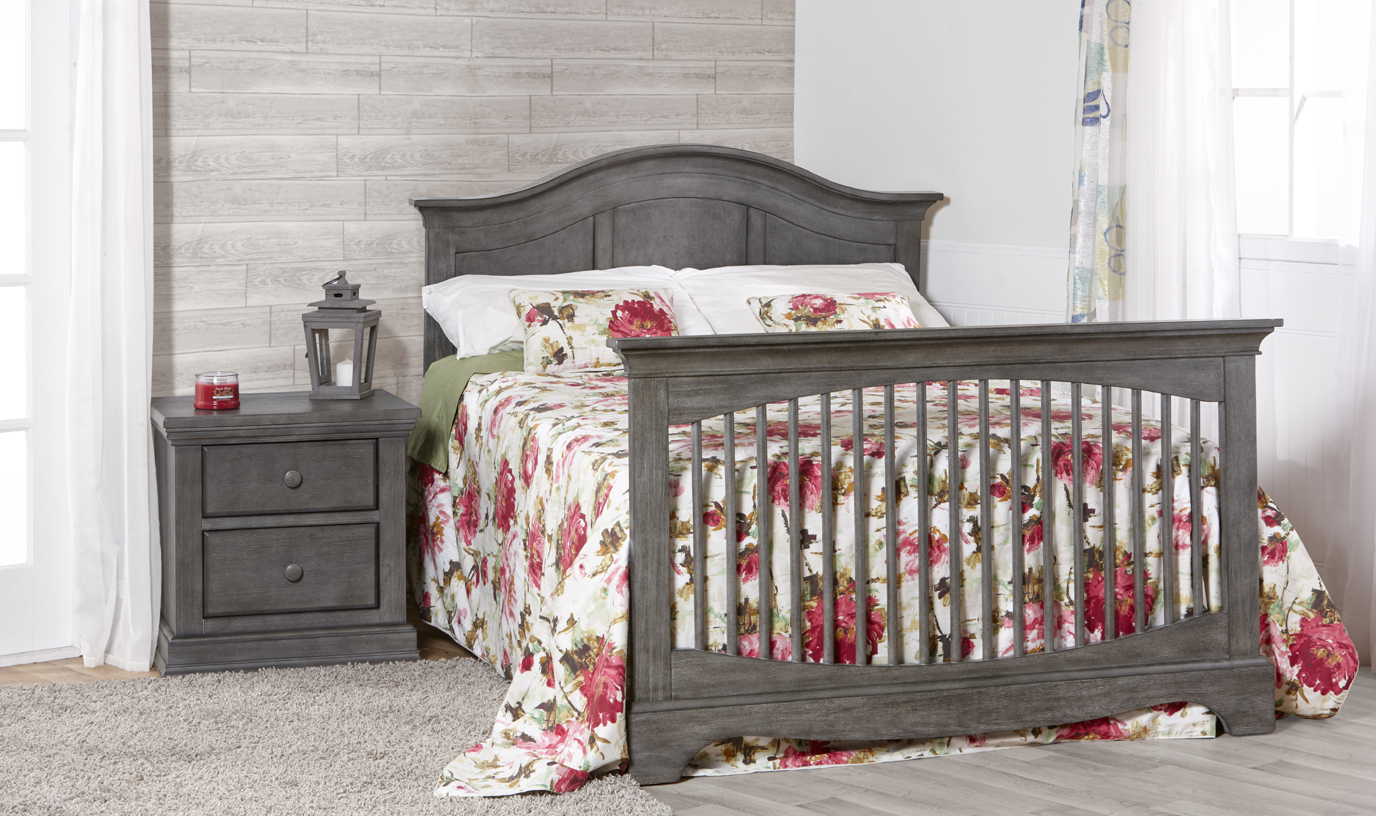 The <b>Enna Forever Crib</b> is a sweet and stylish piece that coordinates nicely with the Ragusa, Marina, Modena and Torino Collections.  Shown here with a 2114 Modena nightstand in <b>Distressed Granite</b>.