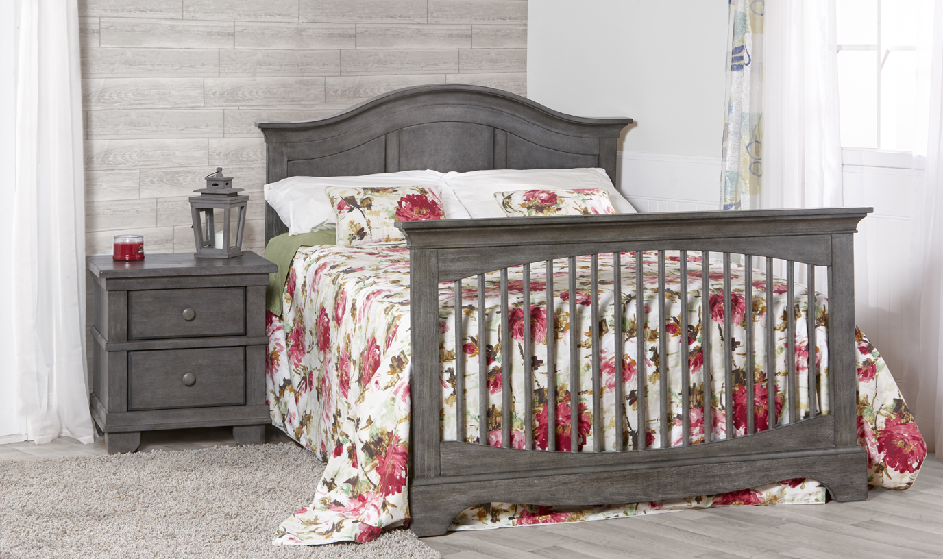 The <b>Enna Forever Crib</b> is a sweet and stylish piece that coordinates nicely with the Ragusa, Marina, Modena and Torino Collections.  Shown here with a 1314 Torino nightstand in <b>Distressed Granite</b>.