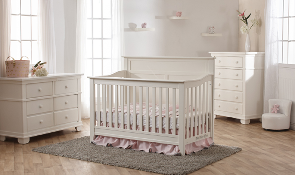 The brand-new Napoli Forever Crib with Flat-Top Headboard, here shown in White with Torino furniture.