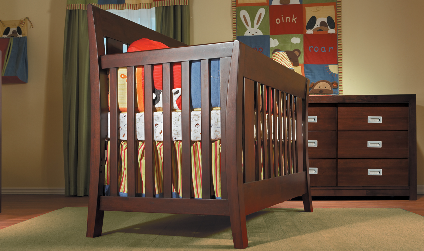 <b>Emilia Forever Crib</b> with a 426 Novara Double Dresser, shown in Mocacchino.