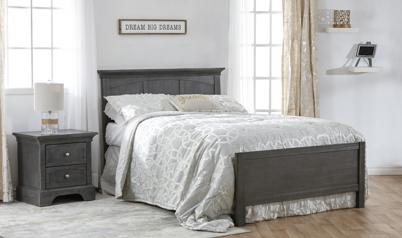 The <b>Ragusa Forever Crib</b>, converted into a <b>full-size bed</b>, with the Low Profile Footboard (sold separately) –