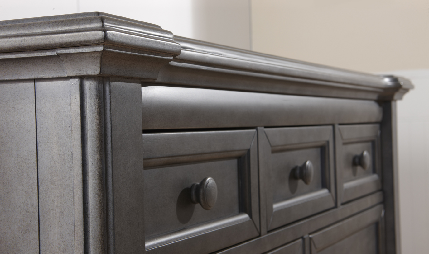 The 2206 <b>Cristallo Double Dresser</b> in Granite. <br>Echoing the facets and beauty of a crystal, the carved layers that step up the top edge of the Cristallo Double Dresser bring a sense of shine to your little one's space.  This dresser, with four large drawers and three small ones, has plenty of room to store everything from blankets to adorable little tees.  Designed with elegant lines and a clean, simple look that hints at a vintage style, this dresser pairs wonderfully with the rest of the Cristallo Collection for a room that is as fashionable as it is functional. <br> In keeping with Pali's commitment to creating fine furniture for your family, the Cristallo Double Dresser is as well made as it is beautiful.  Each of the drawer boxes are crafted from Radiatta Pine, and the drawers move effortlessly on soft-closing drawer glides.  Finished with non-toxic finishes that are regularly tested to ensure that they exceed the required standards for lead, this dresser is available in both Granite and Vintage White.