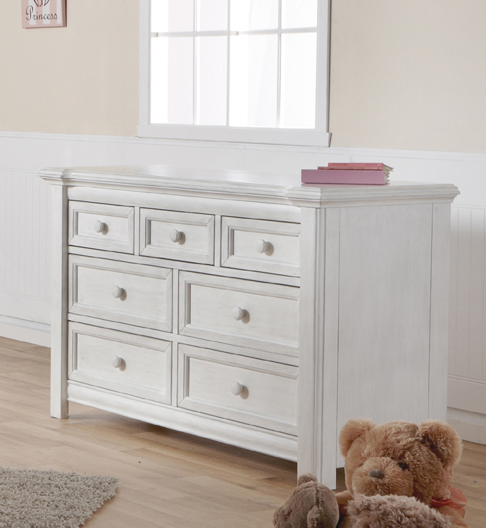 The 2206 <b>Cristallo Double Dresser</b> in Vintage White. <br>Echoing the facets and beauty of a crystal, the carved layers that step up the top edge of the Cristallo Double Dresser bring a sense of shine to your little one's space.  This dresser, with four large drawers and three small ones, has plenty of room to store everything from blankets to adorable little tees.  Designed with elegant lines and a clean, simple look that hints at a vintage style, this dresser pairs wonderfully with the rest of the Cristallo Collection for a room that is as fashionable as it is functional. <br> In keeping with Pali's commitment to creating fine furniture for your family, the Cristallo Double Dresser is as well made as it is beautiful.  Each of the drawer boxes are crafted from Radiata Pine, and the drawers move effortlessly on soft-closing drawer glides.  Finished with non-toxic finishes that are regularly tested to ensure that they exceed the required standards for lead, this dresser is available in both Granite and Vintage White.