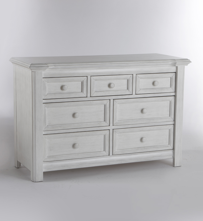 The 2206 <b>Cristallo Double Dresser</b> in Vintage White. <br>Echoing the facets and beauty of a crystal, the carved layers that step up the top edge of the Cristallo Double Dresser bring a sense of shine to your little one's space.  This dresser, with four large drawers and three small ones, has plenty of room to store everything from blankets to adorable little tees.  Designed with elegant lines and a clean, simple look that hints at a vintage style, this dresser pairs wonderfully with the rest of the Cristallo Collection for a room that is as fashionable as it is functional. <br> In keeping with Pali's commitment to creating fine furniture for your family, the Cristallo Double Dresser is as well made as it is beautiful.  Each of the drawer boxes are crafted from Radiatta Pine, and the drawers move effortlessly on soft-closing drawer glides.  Finished with non-toxic finishes that are regularly tested to ensure that they exceed the required standards for lead, this dresser is available in both Granite and Vintage White.
