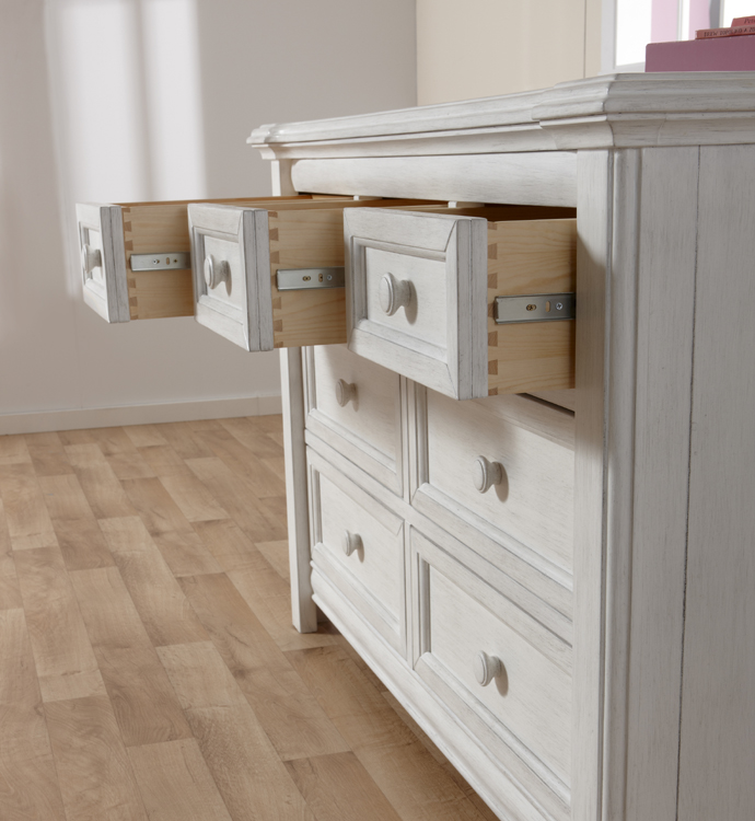 The 2206 <b>Cristallo Double Dresser</b>, here shown in Vintage White, has <b>7 soft-closing drawers</b> . <br>Echoing the facets and beauty of a crystal, the carved layers that step up the top edge of the Cristallo Double Dresser bring a sense of shine to your little one's space.  This dresser, with four large drawers and three small ones, has plenty of room to store everything from blankets to adorable little tees.  Designed with elegant lines and a clean, simple look that hints at a vintage style, this dresser pairs wonderfully with the rest of the Cristallo Collection for a room that is as fashionable as it is functional. <br> In keeping with Pali's commitment to creating fine furniture for your family, the Cristallo Double Dresser is as well made as it is beautiful.  Each of the drawer boxes are crafted from Radiatta Pine, and the drawers move effortlessly on <b>soft-closing drawer glides</b>.  Finished with non-toxic finishes that are regularly tested to ensure that they exceed the required standards for lead, this dresser is available in both Granite and Vintage White.
