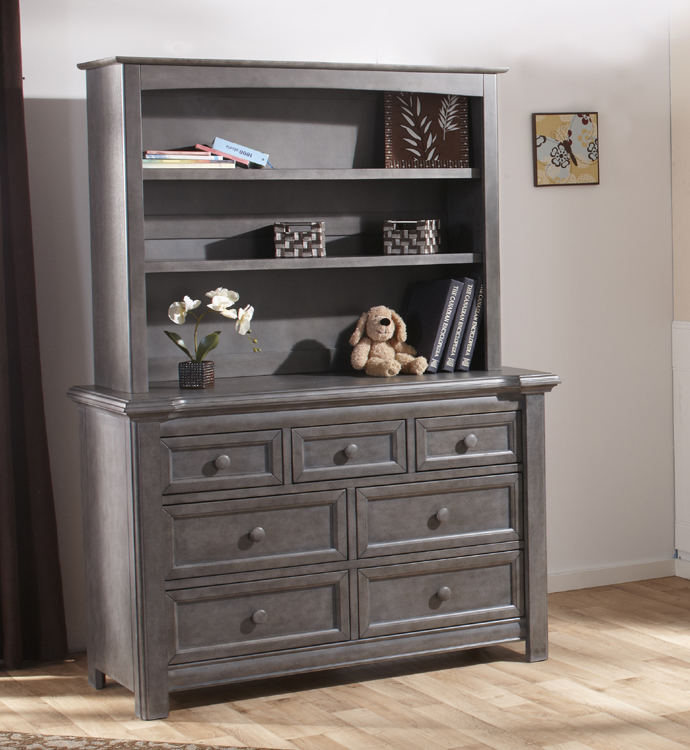 The 2206 <b>Cristallo Double Dresser</b> with a 5555 Bookcase Hutch, in Granite. <br>Echoing the facets and beauty of a crystal, the carved layers that step up the top edge of the Cristallo Double Dresser bring a sense of shine to your little one's space.  This dresser, with four large drawers and three small ones, has plenty of room to store everything from blankets to adorable little tees.  Designed with elegant lines and a clean, simple look that hints at a vintage style, this dresser pairs wonderfully with the rest of the Cristallo Collection for a room that is as fashionable as it is functional. <br> In keeping with Pali's commitment to creating fine furniture for your family, the Cristallo Double Dresser is as well made as it is beautiful.  Each of the drawer boxes are crafted from Radiatta Pine, and the drawers move effortlessly on soft-closing drawer glides.  Finished with non-toxic finishes that are regularly tested to ensure that they exceed the required standards for lead, this dresser is available in both Granite and Vintage White.