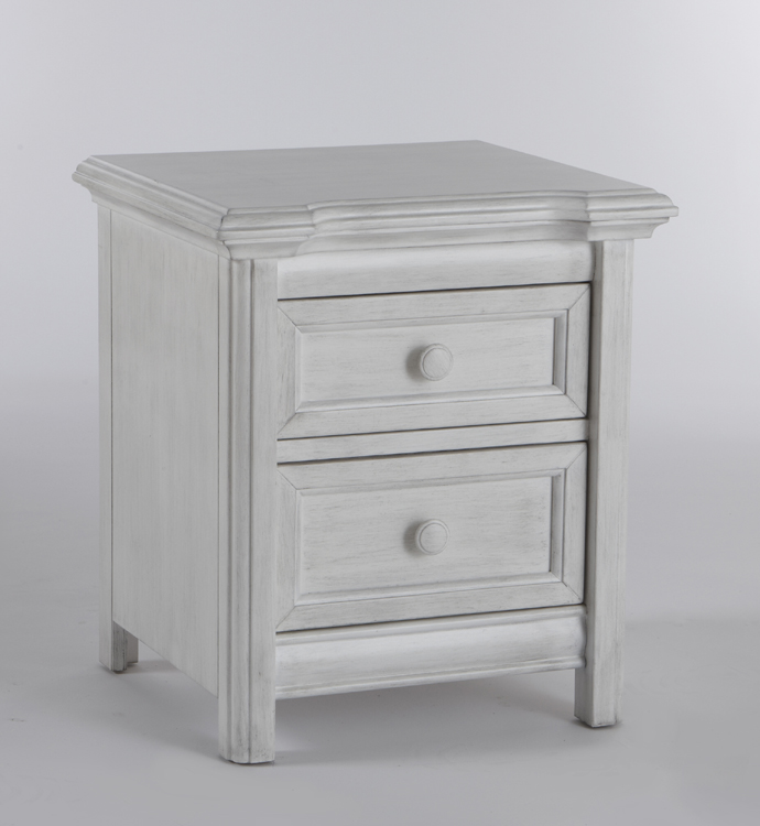 The 2214 <b>Cristallo Nightstand</b>, in Vintage White. <br>Like a little beacon of beauty, this darling nightstand has just enough flare to be a delightfully eye-catching piece in your little one's nursery.  The smoothly rounded moldings that surround the top of the dresser provide a little bit of elegant charm, and the straight legs point of the classic styling of the Cristallo Collection.  Created with two small soft-closing drawers to keep the important things close at hand, the Cristallo Nightstand is a charming addition to any nursery.