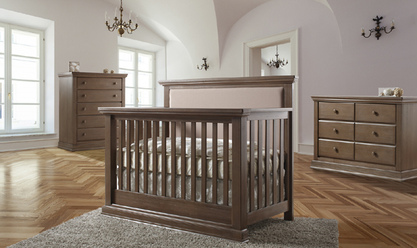 The <b>Modena Forever Crib</b> in  Distressed Desert. It features an awesome upholstered panel in either <b>Taupe fabric</b> or <b>Gray vinyl</b>.