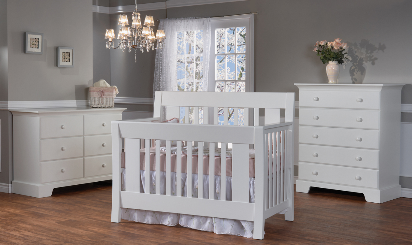 <b>Emilia Forever Crib</b> with a Volterra Double Dresser and a Volterra 5 Drawer Dresser, all shown in White.
