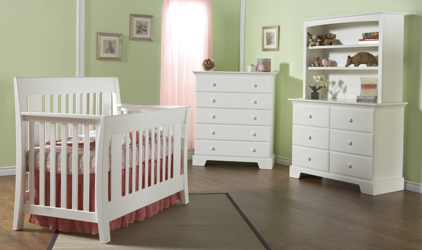 <b>Emilia Forever Crib</b> with a Volterra Double Dresser, a 5555 Bookcase Hutch and a Volterra 5 Drawer Dresser, all shown in White.
