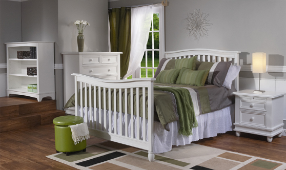 <b>Wendy Full-Size Bed</b> with a 5555 Bookcase, a 1605 Marina 5 Drawer Dresser and a 1614 Marina Nightstand, all shown in White (finish not available). The Wendy Crib can convert into a full-size bed (with the purchase of the Full-Size Bed Rails, sold separately). It can also convert into a toddler bed with the purchase of a Toddler Rail (sold separately).